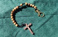 Olive Wood Rosary with a Black cord.