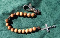 Olive Wood Rosary with a brown cord.