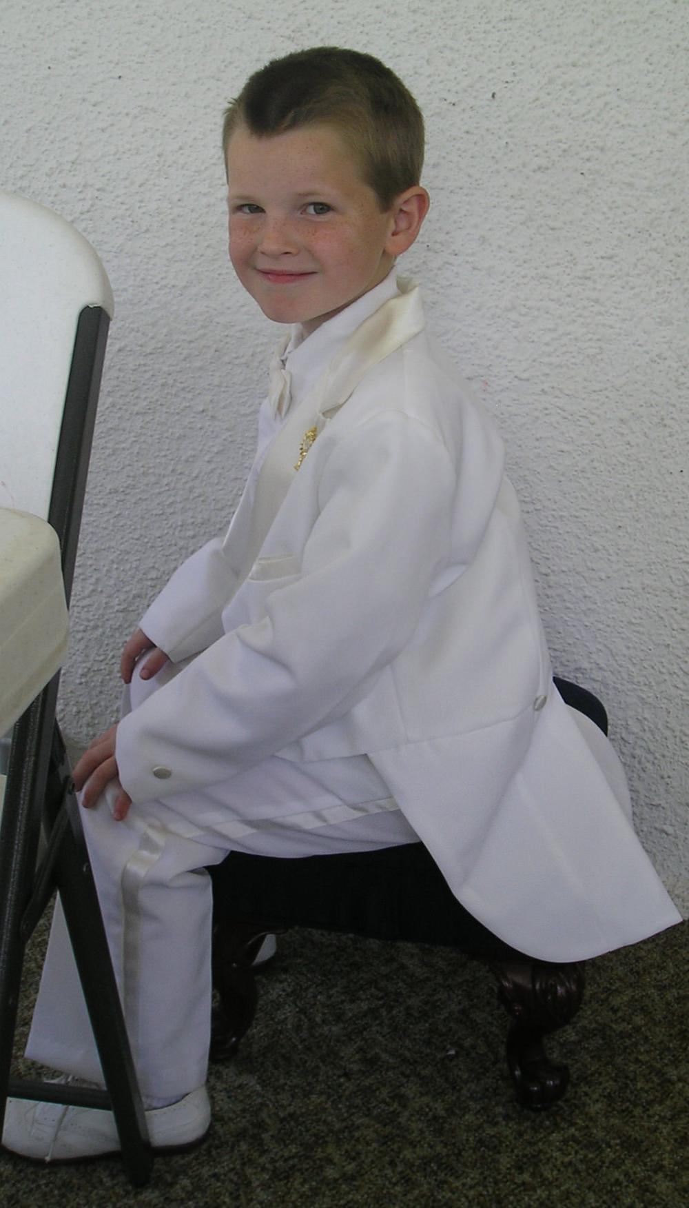First Communion Suits: Tux with bow tie and white shoes.