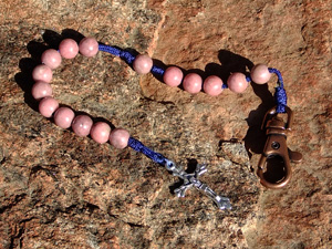Stone Rhodonite rosary made with rhodonite beads. Rhodonite is a beautiful dusty pink stone. This is a perfect stone for your pink loving family and friends.