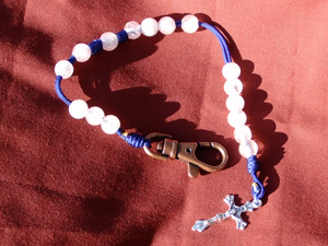 Rose Quartz Bead Rosary on blue cord.