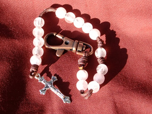 Rose quartz rosary made with Rose Quartz beads. Rose quartz is a type of quartz. It is clear with a slight tint of pink which is a beautiful choice for a gift for a young girl.