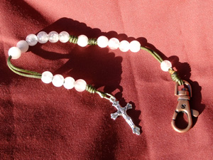 Rose Quartz Stone Rosary made with Rose Quartz beads on green cord.