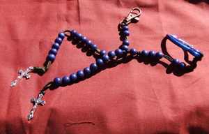 Blue wood rosaries - The colors of the cords that this rosary comes in are black, brown, green, blue or red.  They all come with a nifty little clip at the end of the rosary.