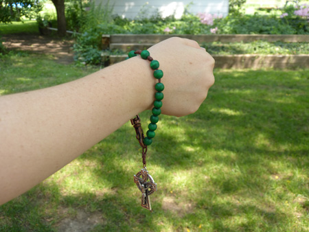 This bracelet rosary has little clips on them. Clip the rosary together and viola you have a bracelet! These glass rosaries come in fun bright colors!