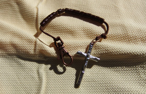 Brown Tube Bead Rosary on a brown cord.