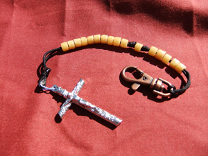 Butterscotch Tube Bead Rosary on a black cord.