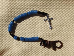 Blue Tube Bead Rosary on a black cord.