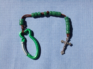 Green Glass Bead Rosary on  a brown cord with a car clip.