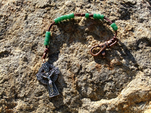 Green Glass Bead Rosary on a brown cord.