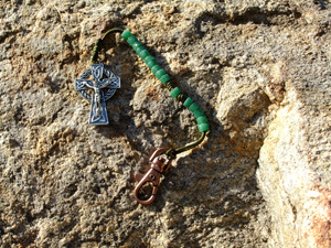 Green Glass Bead Rosary on green cord.