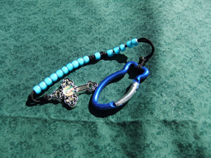 White Heart Turquoise Bead Rosary on brown cord.