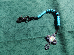 White Heart Turquoise Bead Rosary on a blue cord.