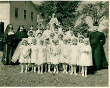 St. Anne's Helper First Communion Catechism and Catholic prayers for children.